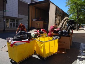 Olympia-sorting-and-loading-the-athletes-luggage-300x225