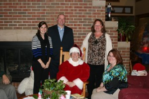 Wheaton representatives with Mrs. Claus. She had story time with the children that are staying at RMH.