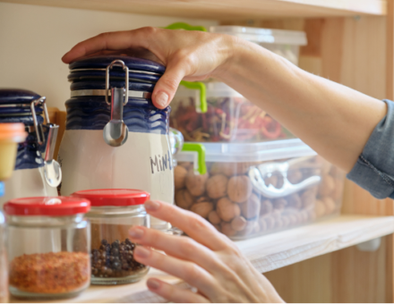 Person grabbing items out of pantry
