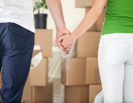 Holding Hands in front of boxes