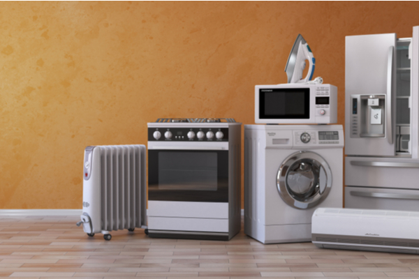 Set of household kitchen appliances on yellow background.