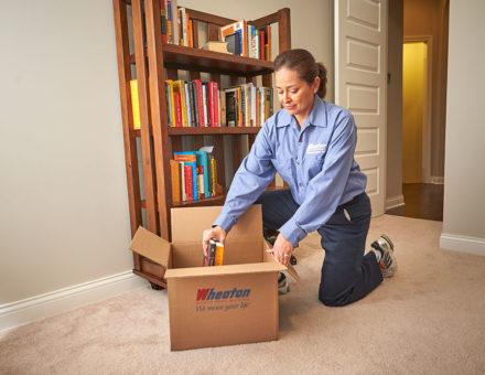 wheaton worker packing books