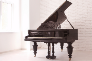grand piano in a white room. Piano moving