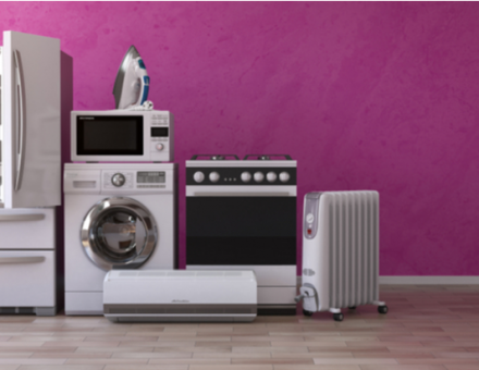 Set of household home appliances on pink background