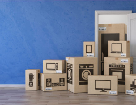 Cardboard boxes with images of electronics labeled on the outside
