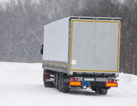 moving truck on winter road