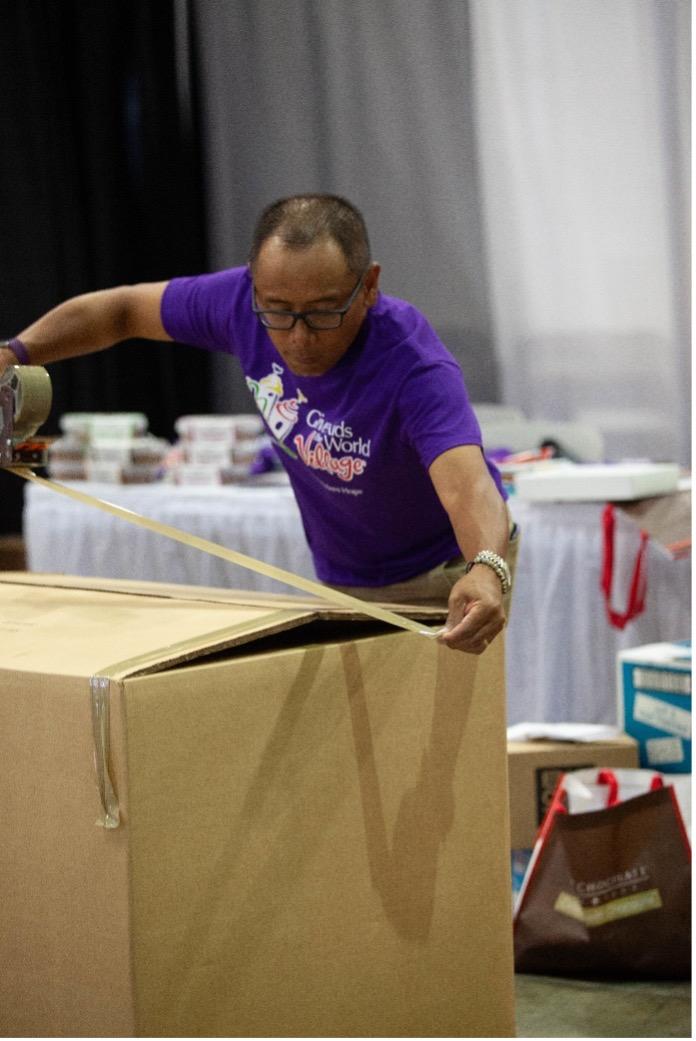 man packing big box