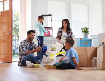 A blended family unpacks in their new home.