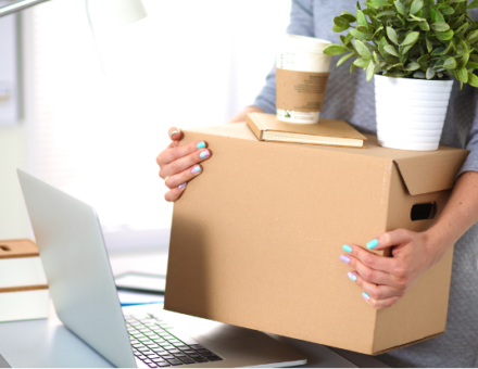 woman packing up belongings to move offices