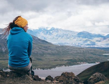 Woman sitting on a mountain